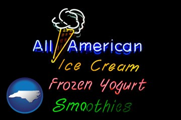 a neon sign, advertising ice cream, frozen yogurt, and smoothies - with North Carolina icon