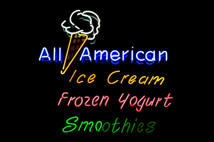 a neon sign, advertising ice cream, frozen yogurt, and smoothies